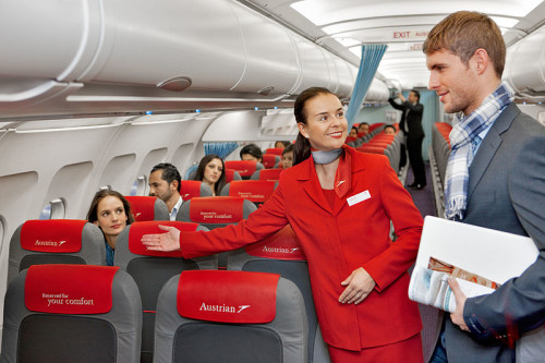 Austrian Airlines Crew Greets Customer - Creative Commons