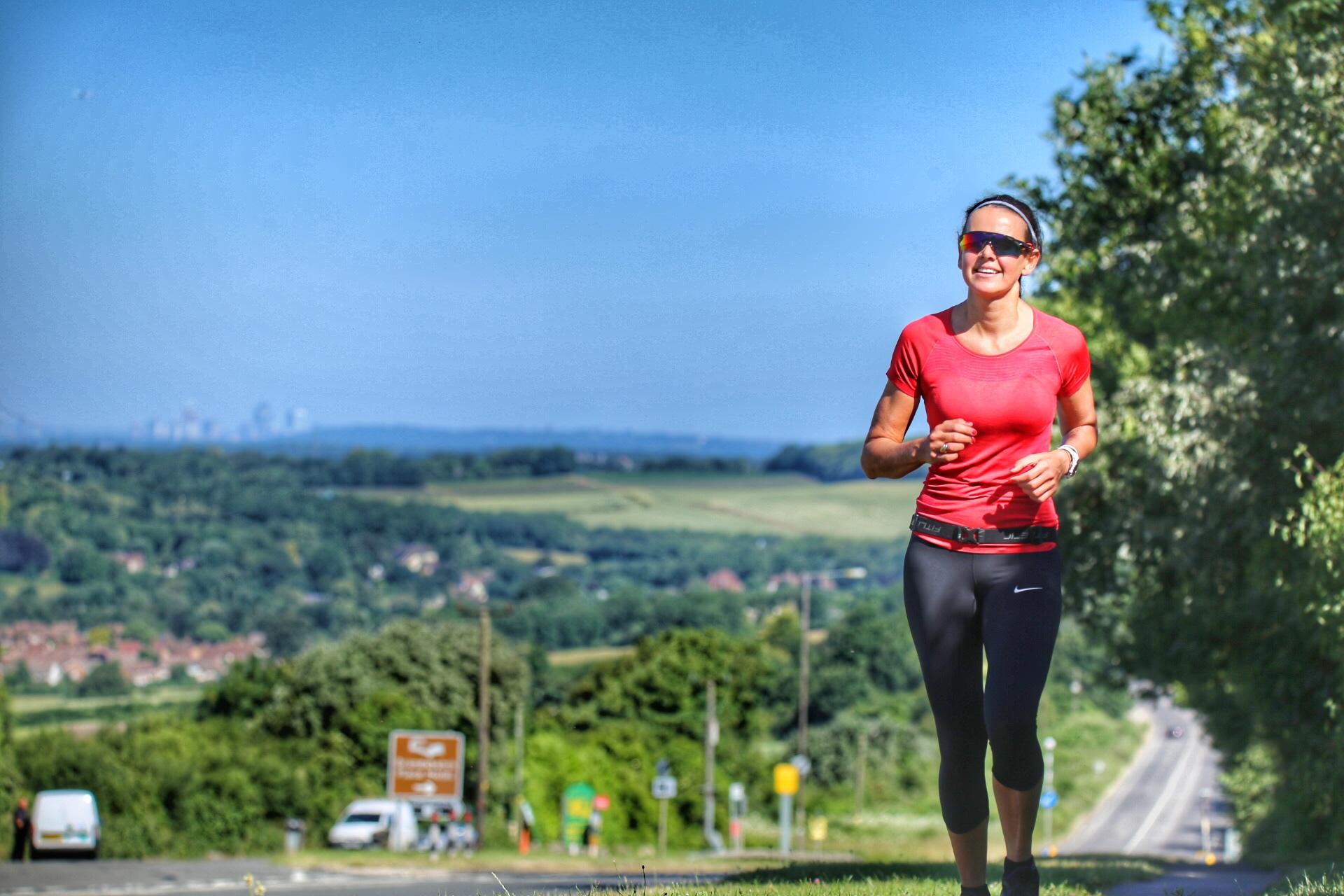 Perrine summitting a hill outside London
