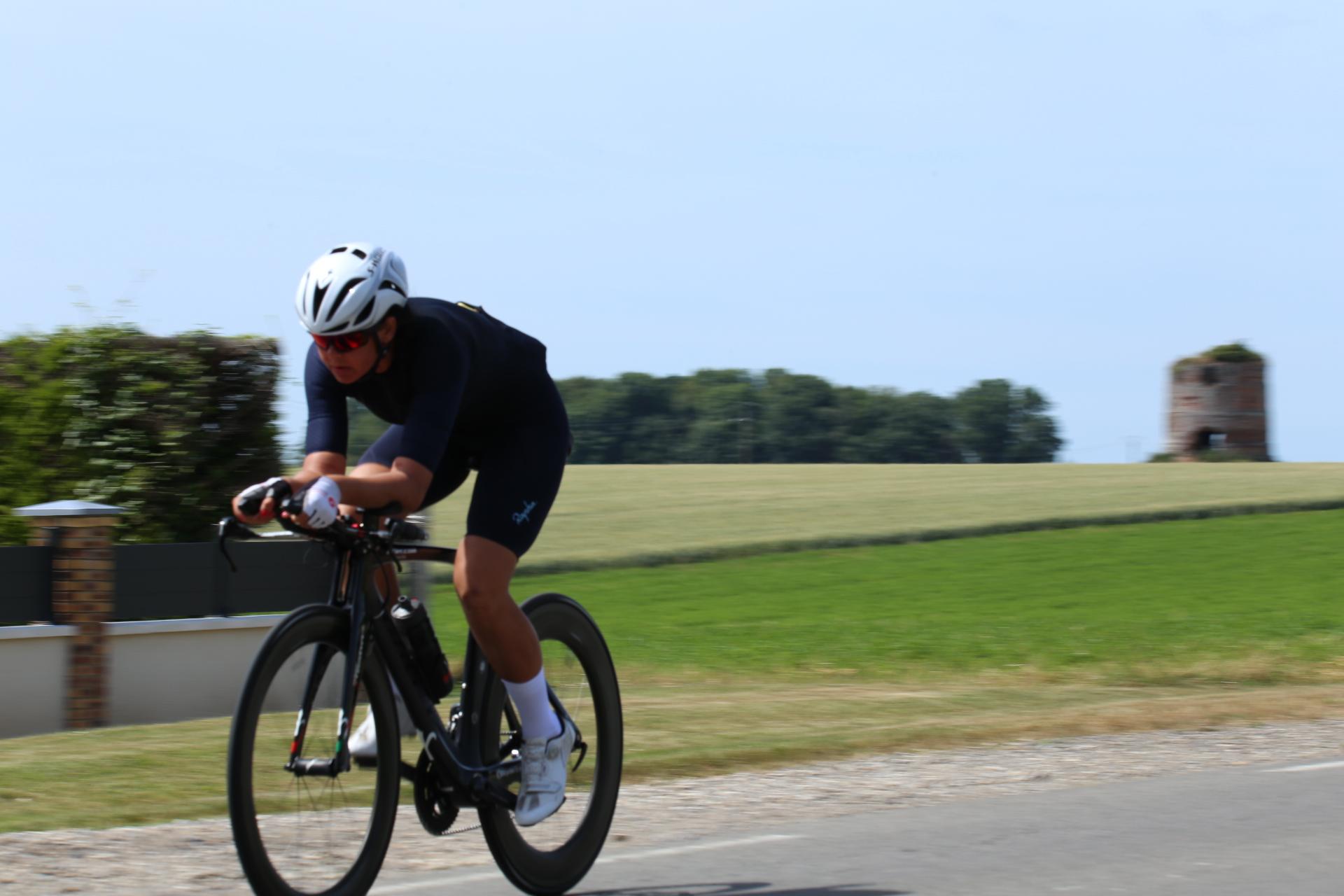 Perrine biking through the French countryside